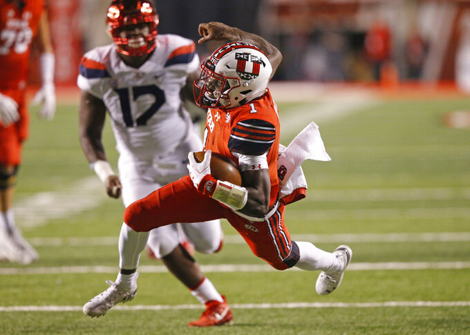 Utah quarterback Tyler Huntley (1) carries the ball against Arizona during the first half of an NCAA college football game Friday, Oct. 12, 2018, in Salt Lake City. (AP Photo/Rick Bowmer)