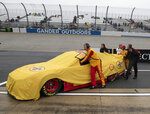 The team of Joey Logano pushes his car off of pit road after a NASCAR Cup Series auto race was postponed due to inclement weather conditions Sunday, May 5, 2019, at Dover International Speedway in Dover, Del. (AP Photo/Jason Minto)