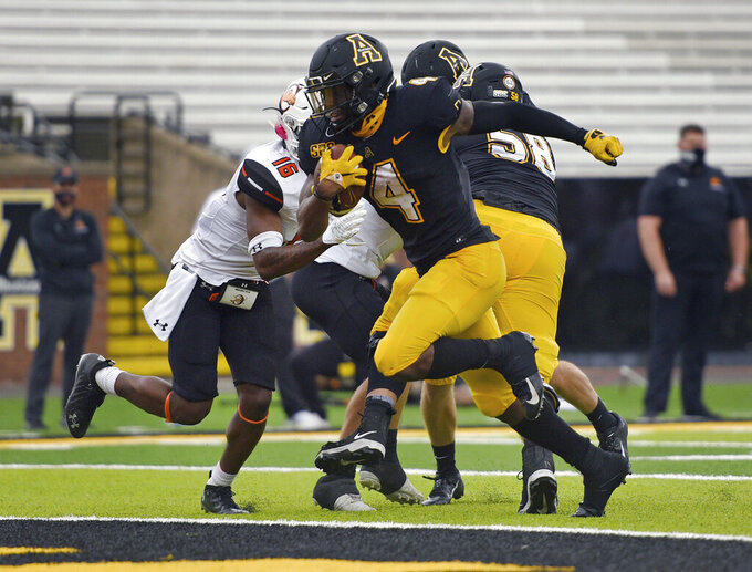 Appalachian St. running back Daetrich Harrington scores on a run during the second half of an NCAA college football game against Campbell, Saturday, Sept. 26, 2020 at Kidd Brewer Stadium in Boone, N.C. (Walt Unks/The Winston-Salem Journal via AP)