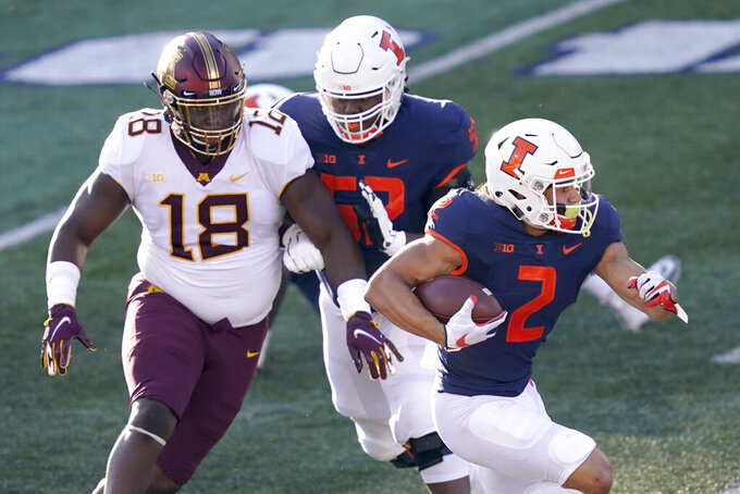 Illinois running back Chase Brown carries the ball during the first half of an NCAA college football game against Minnesota Saturday, Nov. 7, 2020, in Champaign, Ill. (AP Photo/Charles Rex Arbogast)