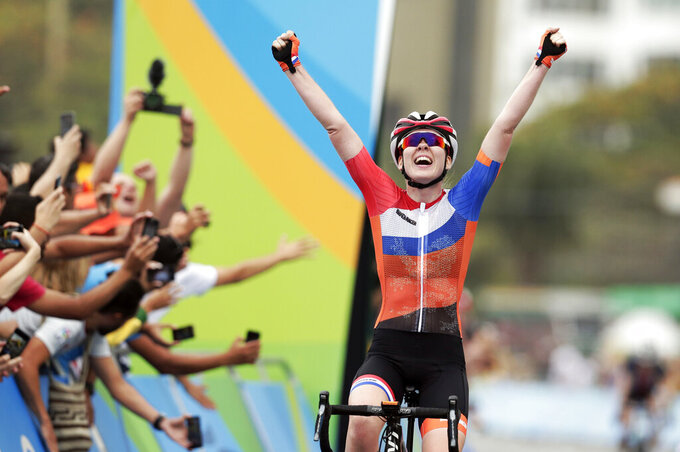 """FILE - Anna Van Der Breggen, of the Netherlands, celebrates after crossing the finishing line to win the women's cycling road race final at the 2016 Summer Olympics in Rio de Janeiro, Brazil, in this Sunday, Aug. 7, 2016, file photo. The men's and women's road races kick off the cycling program at every Summer Olympics. """"Everybody in the world is trying to figure out how to beat the Dutch girls,"""" said Jim Miller, the high performance director for USA Cycling. (AP Photo/Victor R. Caivano, File)"""