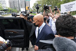 Tom Barrack, center, leaves Brooklyn federal court, Monday, July 26, 2021, in New York. Barrack was among three men charged in New York federal court with trying to influence foreign policy while Donald Trump was running in 2016 and later while president. The chair of former President Donald Trump's 2017 inaugural committee allegedly conspired to influence U.S. policy to benefit the United Arab Emirates, even while he was seeking a position as an American diplomat. (AP Photo/Mark Lennihan)