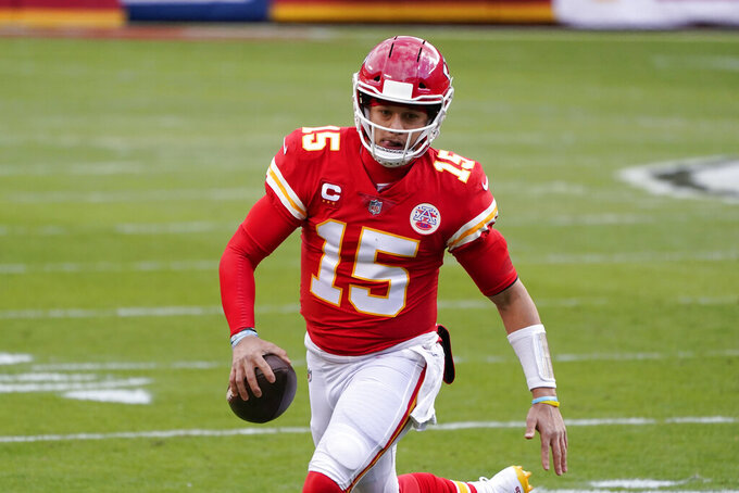 Kansas City Chiefs quarterback Patrick Mahomes runs during the first half of an NFL divisional round football game against the Cleveland Browns, Sunday, Jan. 17, 2021, in Kansas City. (AP Photo/Charlie Riedel)