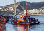 Migrants arrive onboard a maritime rescue ship at the Arguineguin port in Gran Canaria island, Spain, after being rescued in the Atlantic Ocean on Tuesday, Oct. 17, 2020. Under increasing pressure from the steady build-up of Africans' arrivals to its southern Canary Islands, the Spanish government has launched an all-front offensive, including active diplomacy, to avoid becoming the next black spot on Europe's failing record handling migration flows. (AP Photo/Javier Bauluz)