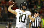 Oregon quarterback Justin Herbert throws down field against Arizona in the first half during an NCAA college football game, Saturday, Oct. 27, 2018, in Tucson, Ariz. (AP Photo/Rick Scuteri)
