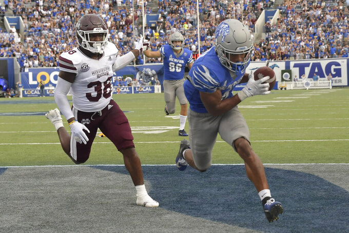 Memphis wide receiver Calvin Austin III (4) makes a reception for a touchdown as Mississippi State safety Fred Peters (38) follows during the second half of an NCAA college football game on Saturday, Sept. 18, 2021, in Memphis, Tenn. (AP Photo/John Amis)