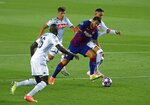Barcelona's Luis Suarez, second right, in action eduring the Champions League round of 16, second leg soccer match between Barcelona and Napoli at the Camp Nou Stadium in Barcelona, Spain, Saturday, Aug. 8, 2020. (AP Photo/Joan Monfort)