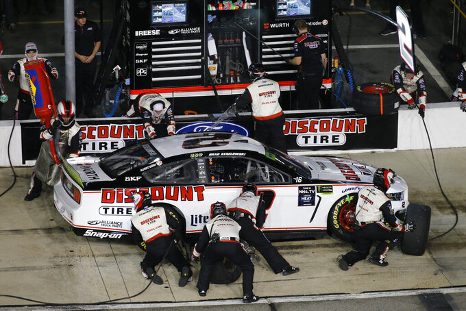 Brad Keselowski makes a pit stop during the NASCAR Cup Series auto race at Richmond Raceway in Richmond, Va., Saturday, Sept. 21, 2019. (AP Photo/Steve Helber)