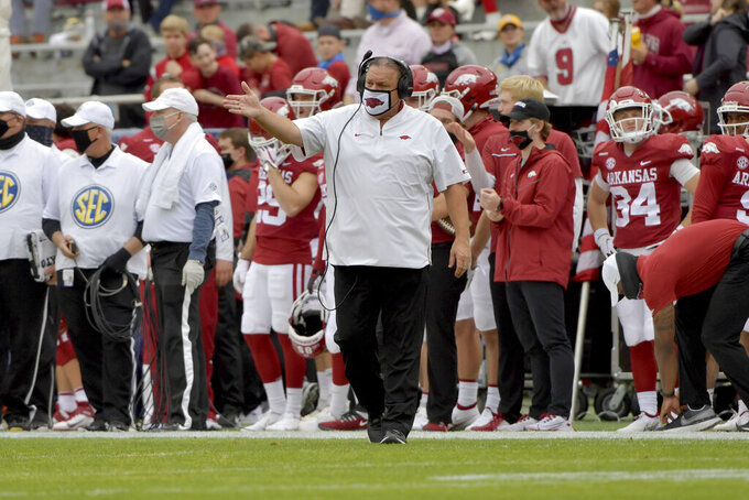 Arkansas head coach Sam Pittman, center, gestures on the sideline during the second half of an NCAA college football game against LSU, Saturday, Nov. 21, 2020, in Fayetteville, Ark. (AP Photo/Michael Woods)