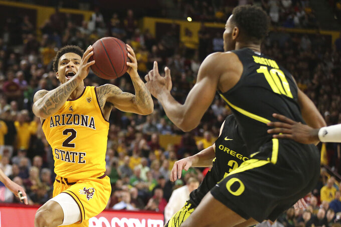 Arizona State's Rob Edwards (2) drives to the basket against Oregon's Shakur Juiston (10) during the second half of an NCAA college basketball game Thursday, Feb. 20, 2020, in Tempe, Ariz. (AP Photo/Darryl Webb)