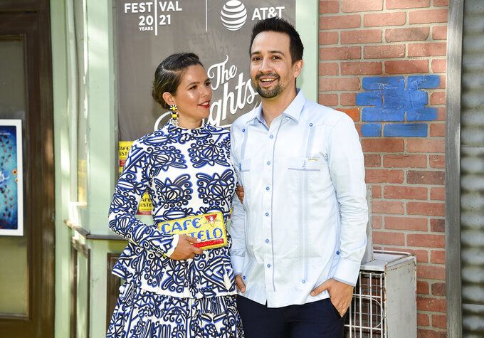 """Producer Lin-Manuel Miranda, right, and wife Vanessa Nadal attend the 2021 Tribeca Film Festival opening night premiere of """"In The Heights"""" at the United Palace theater on Wednesday, June 9, 2021, in New York. (Photo by Evan Agostini/Invision/AP)"""