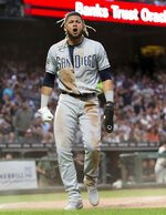 San Diego Padres' Fernando Tatis Jr. reacts after scoring against the San Francisco Giants during the fifth inning of a baseball game, Tuesday, June 11, 2019, in San Francisco. (AP Photo/John Hefti)