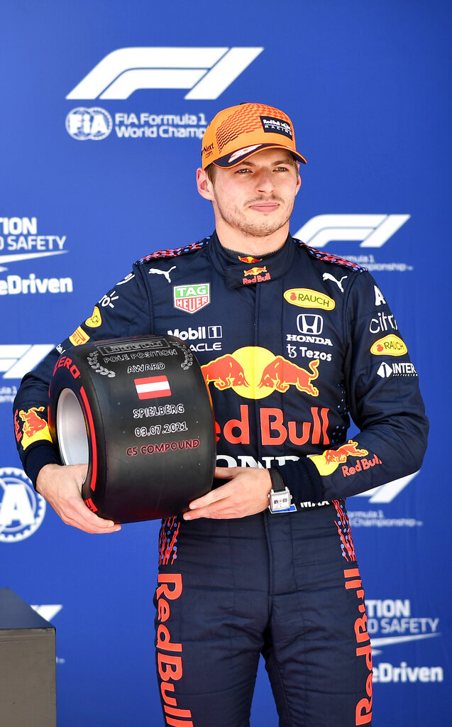 First place for pole position, Red Bull driver Max Verstappen of the Netherlands holds his prize after the qualifying session ahead of the Austrian Formula One Grand Prix at the Red Bull Ring racetrack in Spielberg, Austria, Saturday, July 3, 2021. The Austrian Grand Prix will be held on Sunday. (Christian Bruna/Pool Photo via AP)