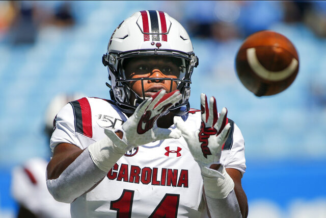 FILE - In this Aug. 31, 2019, file photo, South Carolina running back Deshaun Fenwick warms up prior to an NCAA college football game against North Carolina in Charlotte, N.C. For the college athletes who are heading into a season of uncertainty brought on by COVID-19, the NCAA's decision to not charge them a year of eligibility, no matter how much they play, brings peace of mind. (AP Photo/Nell Redmond, File)