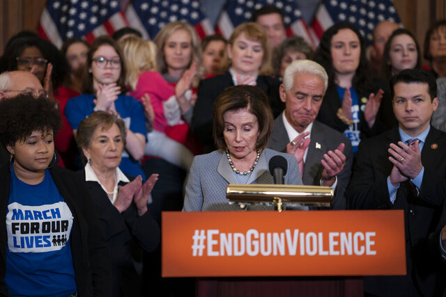 Speaker of the House Nancy Pelosi, D-Calif., with fellow Democrats and members of Moms Demand Action, marks the one-year anniversary of passage in the House of the Bipartisan Background Check Act to close loopholes for gun purchases, during a news conference on Capitol Hill in Washington, Thursday, Feb. 27, 2020. (AP Photo/J. Scott Applewhite)