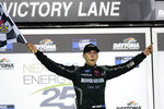 Ben Rhodes celebrates in Victory Lane after winning the NASCAR Trucks auto race at Daytona International Speedway, Friday, Feb. 12, 2021, in Daytona Beach, Fla. (AP Photo/John Raoux)