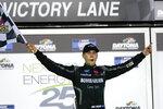 Ben Rhodes celebrates in Victory Lane after winning the NASCAR Trucks auto race at Daytona International Speedway, Friday, Feb. 12, 2021, in Daytona Beach, Fla. (AP Photo/John Raoux)