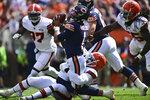 Cleveland Browns defensive end Myles Garrett (95) sacks Chicago Bears quarterback Justin Fields (1) during the first half of an NFL football game, Sunday, Sept. 26, 2021, in Cleveland. (AP Photo/David Dermer)