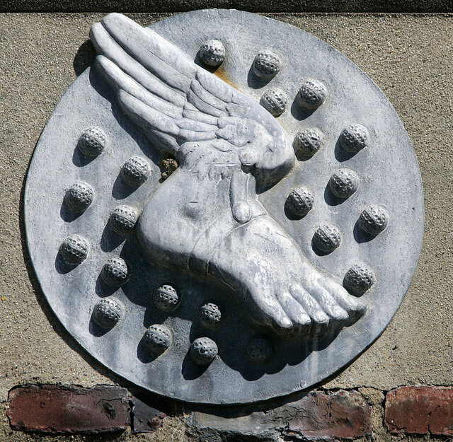 FILE - In this May 22, 2006, file photo, a large plaque depicting a winged foot and golf balls is seen on the wall of the clubhouse at Winged Foot Golf Club Monday in Mamaroneck, N.Y. Winged Foot will be the site of next week's U.S. Open. (AP Photo/Mel Evans, File)