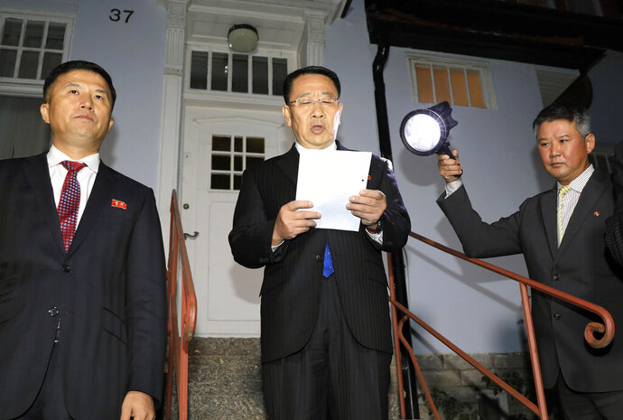 North Korean negotiator Kim Miyong Gil, center, reads statement outside the North Korean Embassy in Stockholm, Sweden, Saturday, Oct. 5, 2019. North Korea's chief negotiator said Saturday that discussions with the U.S. on Pyongyang's nuclear program have broken down, but Washington said the two sides had