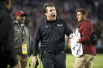 South Carolina head coach Will Muschamp, center, shouts at an official during the second half of an NCAA college football game against Tennessee, Saturday, Oct. 27, 2018, in Columbia, S.C. (AP Photo/Sean Rayford)