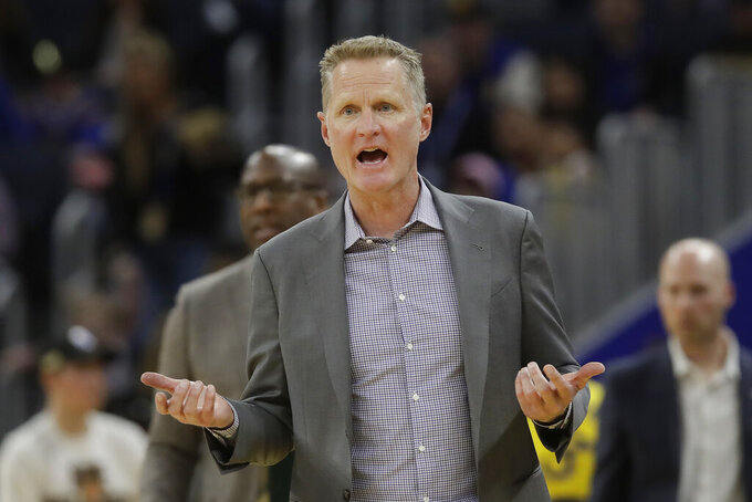 Golden State Warriors head coach Steve Kerr reacts toward officials during the second half of his team's NBA basketball game against the Washington Wizards in San Francisco, Sunday, March 1, 2020. (AP Photo/Jeff Chiu)