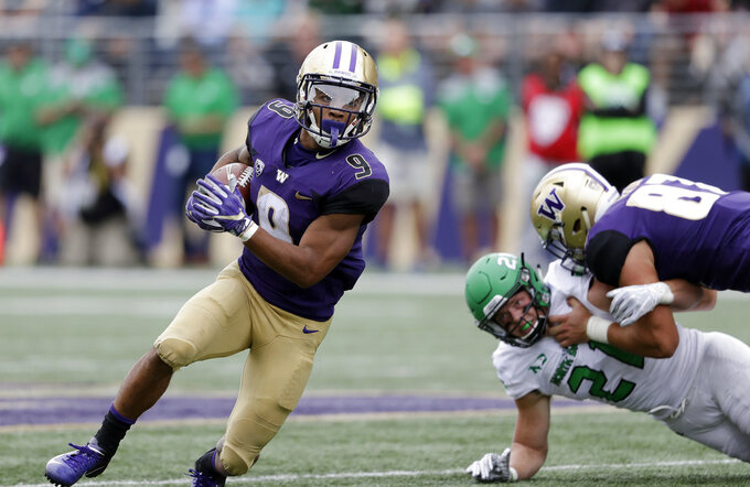Washington's Myles Gaskin (9) rushes against North Dakota in the first half of an NCAA college football game Saturday, Sept. 8, 2018, in Seattle. (AP Photo/Elaine Thompson)