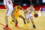 Wisconsin's Brad Davison (34) drives against Maryland's Aaron Wiggins (2) during the first half of an NCAA college basketball game Tuesday, Jan. 14, 2020, in Madison, Wis. (AP Photo/Andy Manis)