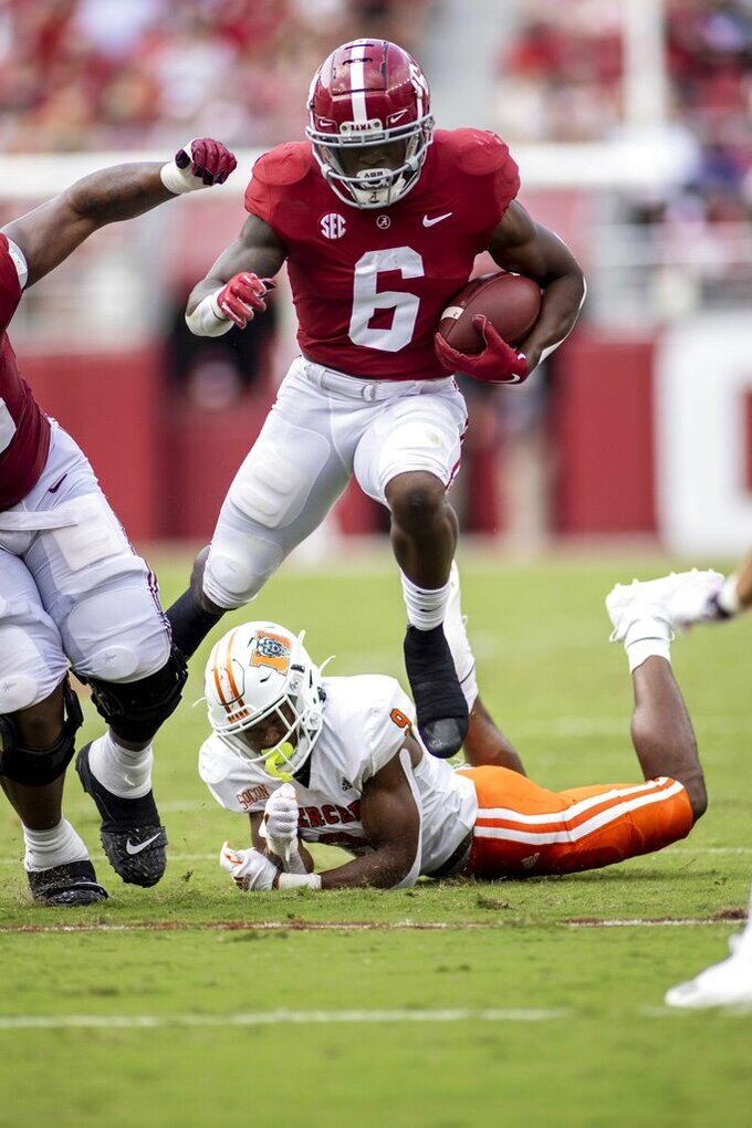 Alabama running back Trey Sanders (6) runs over Mercer defensive back Michael Campbell (9) during the first half of an NCAA college football game, Saturday, Sept. 11, 2021, in Tuscaloosa, Ala. (AP Photo/Vasha Hunt)