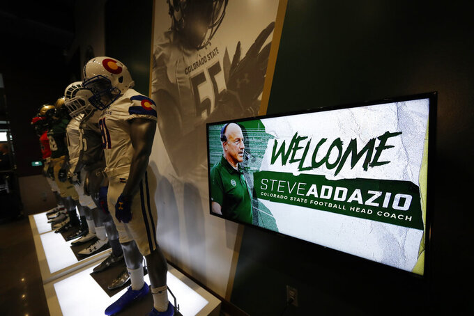 A welcome sign flashes during an announcement that Steve Addazio has been hired as the new head football coach at Colorado State University at a news conference at the school Thursday, Dec. 12, 2019, in Fort Collins, Colo. (AP Photo/David Zalubowski)