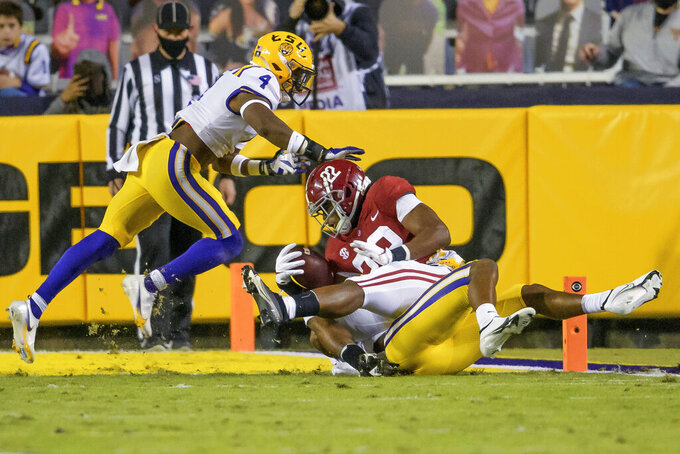 Alabama running back Najee Harris (22) is stopped just short of a touchdown against LSU during the first half of an NCAA college football game in Baton Rouge, La., Saturday, Dec. 5, 2020. (AP Photo/Matthew Hinton)
