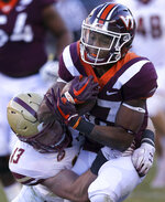 Virginia Tech running back Deshawn McClease (33) is tackled by Boston College defender Connor Strachan (13) in the first half of an NCAA college football game in Blacksburg Va., Saturday, Nov. 3, 2018. (Matt Gentry/The Roanoke Times via AP)