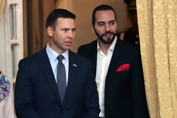 Acting U.S. Homeland Security Secretary Kevin McAleenan, left, and Salvadoran President Nayib Bukele attend a meeting in San Salvador, El Salvador, Wednesday, Aug. 28, 2019. (AP Photo/Salvador Melendez)