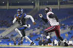 Kentucky quarterback Terry Wilson (3) scrambles during the second half of the team's NCAA college football game against South Carolina, Saturday, Dec. 5, 2020, in Lexington, Ky. (AP Photo/Bryan Woolston)