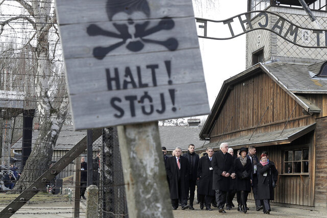 Germany's President Frank-Walter Steinmeier, center, and his wife Elke Buedenbender enter the Auschwitz I Nazi death camp in Oswiecim, Poland, Monday, Jan. 27, 2020. Heads of State and survivors of the Auschwitz-Birkenau death camp gathered Monday for commemorations marking the 75th anniversary of the Soviet army's liberation of the camp, using the testimony of survivors to warn about the signs of rising anti-Semitism and hatred in the world today. (AP Photo/Markus Schreiber)