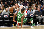 Boston Celtics guard Brad Wanamaker (9) was charged for a foul against Washington Wizards guard Garrison Mathews, back, during the first half of an NBA basketball game, Monday, Jan. 6, 2020, in Washington. (AP Photo/Nick Wass)
