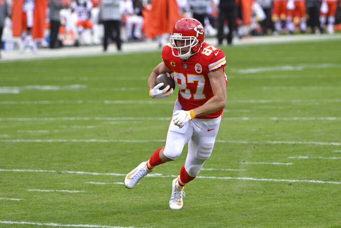 Kansas City Chiefs tight end Travis Kelce scores on a 20-yard touchdown reception during the first half of an NFL divisional round football game against the Cleveland Browns, Sunday, Jan. 17, 2021, in Kansas City. (AP Photo/Reed Hoffmann)