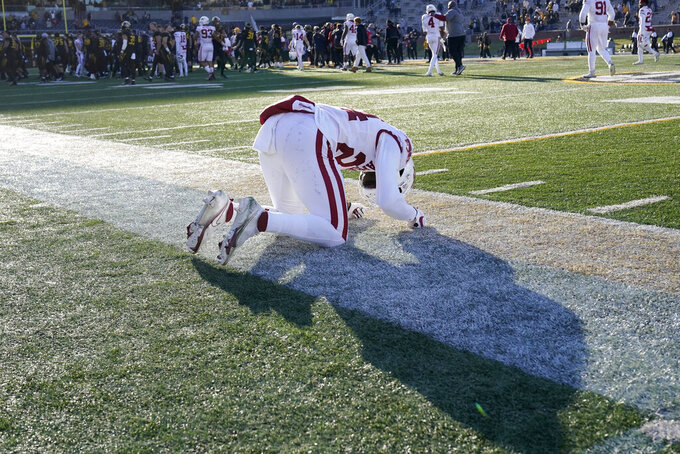Arkansas defensive back LaDarrius Bishop reacts following an NCAA college football game against Missouri Saturday, Dec. 5, 2020, in Columbia, Mo. Missouri won the game 50-48 on a last-second field goal by Harrison Mevis. (AP Photo/L.G. Patterson)