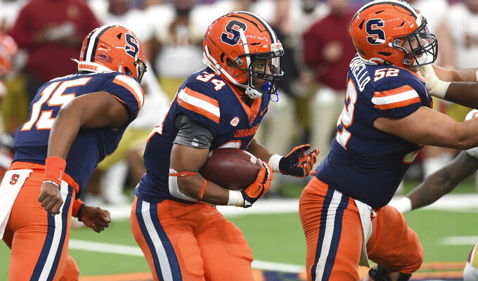 Syracuse running back Sean Tucker (34) runs against Boston College during the first half of NCAA college football game, Saturday, Nov. 7, 2020, at the Carrier Dome in Syracuse, N.Y. (Dennis Nett/The Post-Standard via AP)