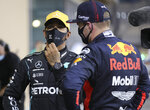 Red Bull driver Max Verstappen of the Netherlands, rught, talks to Mercedes driver Lewis Hamilton of Britain after the qualifying session at the Formula One Abu Dhabi Grand Prix in Abu Dhabi, United Arab Emirates, Saturday, Dec. 11, 2020. (AP Photo/Kamran Jebreili, Pool)