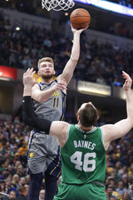 Indiana Pacers forward Domantas Sabonis (11) shoots over Boston Celtics center Aron Baynes (46) during the first half of an NBA basketball game in Indianapolis, Friday, April 5, 2019. (AP Photo/Michael Conroy)