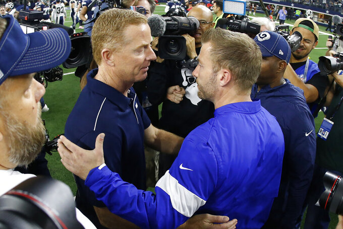 Dallas Cowboys head coach Jason Garrett, left, greets Los Angeles Rams head coach Sean McVay, right, at midfield following an NFL football game in Arlington, Texas, Sunday, Dec. 15, 2019. (AP Photo/Ron Jenkins)