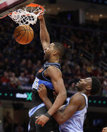 Cleveland Cavaliers' Tristan Thompson, left, dunks against Memphis Grizzlies' Jaren Jackson Jr. in the second half of an NBA basketball game, Friday, Dec. 20, 2019, in Cleveland. (AP Photo/Tony Dejak)