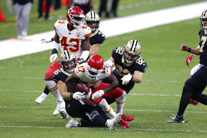 Kansas City Chiefs wide receiver Mecole Hardman (17) is brought down by New Orleans Saints Kaden Elliss (55) and Adam Trautman (82) on a punt return in the first half of an NFL football game in New Orleans, Sunday, Dec. 20, 2020. (AP Photo/Butch Dill)