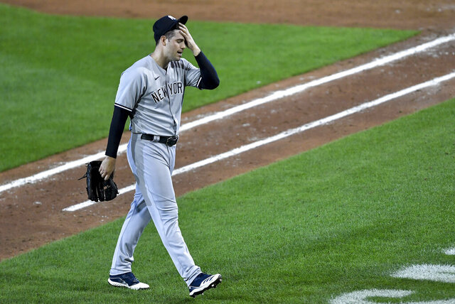 New York Yankees pitcher Adam Ottavino walks to the dugout after being pulled during the sixth inning of a baseball game against the Toronto Blue Jays in Buffalo, N.Y., Monday, Sept. 7, 2020. (AP Photo/Adrian Kraus)