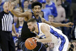 Creighton's Mitch Ballock (24) is guarded by Villanova's Jermaine Samuels, rear, during the first half of an NCAA college basketball game in Omaha, Neb., Tuesday, Jan. 7, 2020. (AP Photo/Nati Harnik)