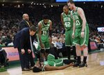 Boston Celtics head coach Brad Stevens and players look at Jaylen Brown who was hurt on a play during the first half of Game 5 of a second round NBA basketball playoff series against the Milwaukee Bucks Wednesday, May 8, 2019, in Milwaukee. (AP Photo/Morry Gash)