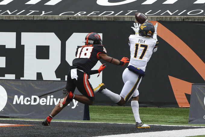 California wide receiver Makai Polk (17) catches a pass in the end zone for a touchdown while under pressure from Oregon State wide receiver Zeriah Beason (18) during the first half of an NCAA college football game in Corvallis, Ore., Saturday, Nov. 21, 2020. (AP Photo/Amanda Loman)
