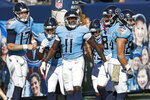 Tennessee Titans wide receiver A.J. Brown (11) celebrates with quarterback Ryan Tannehill (17) after they teamed up for a 40-yard touchdown pass against the Chicago Bears in the first half of an NFL football game Sunday, Nov. 8, 2020, in Nashville, Tenn. (AP Photo/Wade Payne)