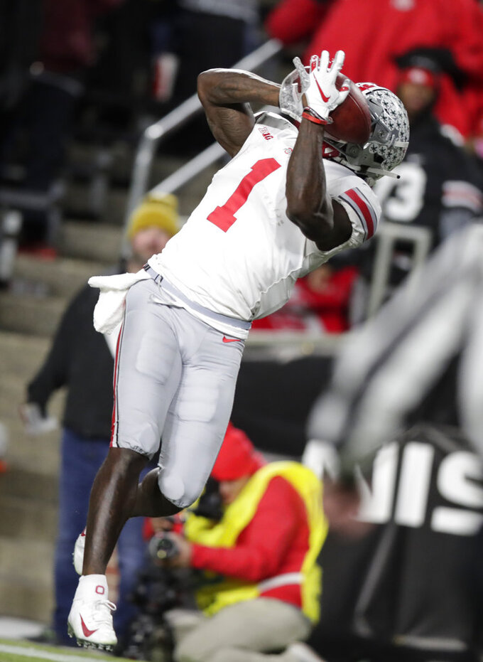Ohio State wide receiver Johnnie Dixon (1) makes a catch in the end zone for a touchdown against Purdue during the second half of an NCAA college football game in West Lafayette, Ind., Saturday, Oct. 20, 2018. Purdue defeated Ohio State 49-20. (AP Photo/Michael Conroy)